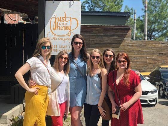 "Group of women outside ""Just Add Honey Tea Company"""